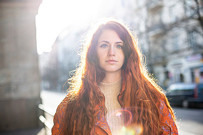 Portrait of young woman with red hair - p975m2223792 by Hayden Verry