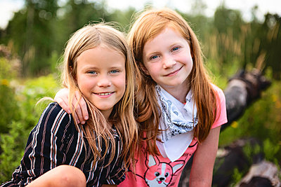 Two Young Girls Playing Outdoors - p1166m2207812 by Cavan Images