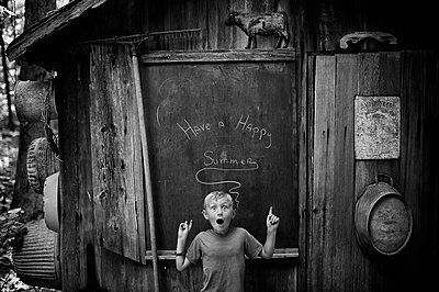 Boy With Happy Summer Sign - p1169m955986 by Tytia Habing