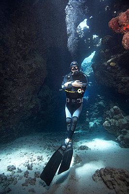 Diver in underwater cave - p4298026 by Zac Macaulay
