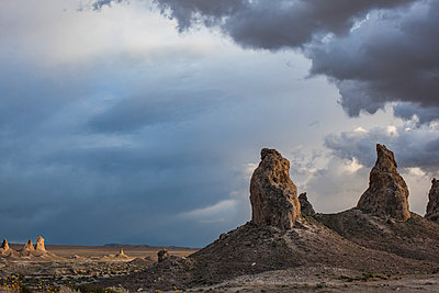 Trona Pinacles At Sunset With Dramatic Clouds - p1291m1548122 by Marcus Bastel