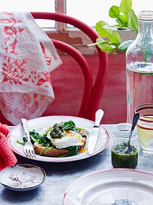 Poached eggs with avocado salsa verde - p429m954383f by BRETT STEVENS