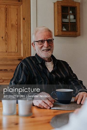 Senior man having coffee - p312m2191261 by Jennifer Nilsson