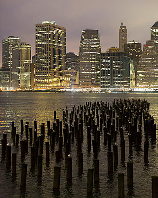 Manhattan skyline seen from Hudson river with groins - p1542m2209890 by Roger Grasas