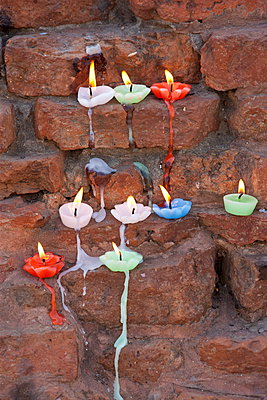 Lighted candles offering Buddhist prayers at Dharmarajika Stupa at Sarnath near Varanasi; Northern India - p871m923036 by Tim Graham