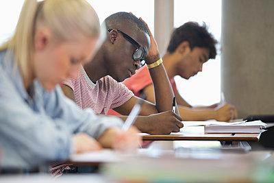 University students taking exam - p1023m987105f by David Schaffer