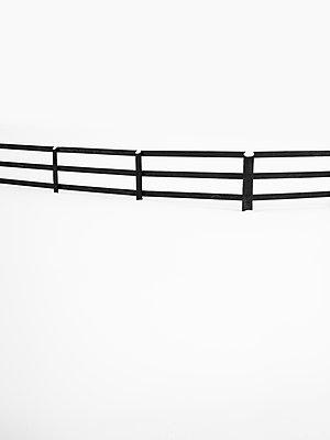 Wooden fence across field of snow - p1335m1586385 by Daniel Cullen