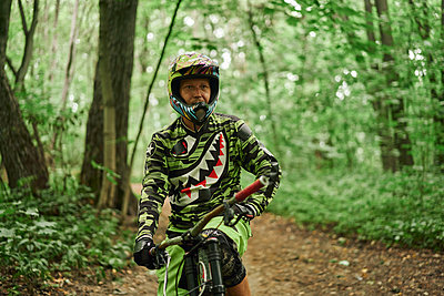 Mountainbiker with safety helmet - p1630m2289106 by Sergey Mironov
