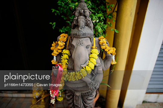 High angle view of Ganesha statue with floral garland