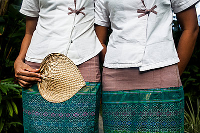 Staff members in traditional dress at the Governor's Residence Hotel in Yangon. - p343m1090135 by Aaron Joel Santos