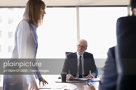 Female lawyer leading conference room meeting