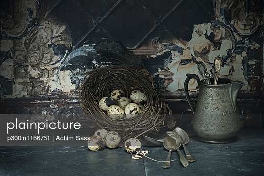 Easter nest of quail eggs, silver spoons and jar