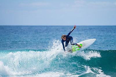 Boy surfing in the sea - p300m1460498 by Simona Pilolla