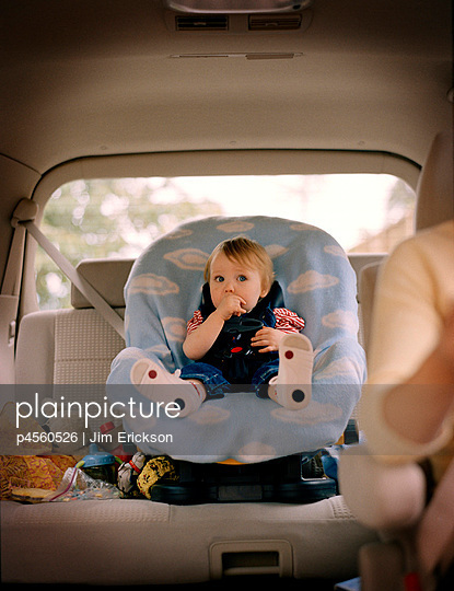 mom drives baby in car seat - p4560526 by Jim Erickson