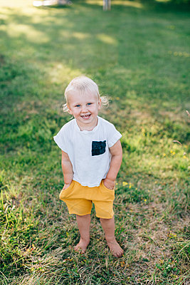 Toddler looking at camera - p312m2050185 by Anna Rostrom