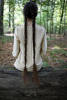 Woman with long braids - p045m953740 by Jasmin Sander