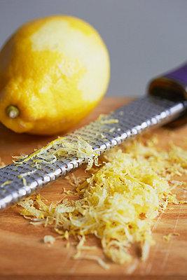 Close up of grated lemon peel - p429m757552f by Danielle Wood