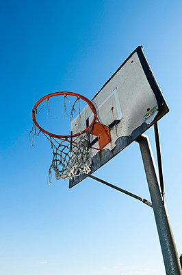 An old basket goal against the sky, Sweden. - p31224884f by Hans Berggren