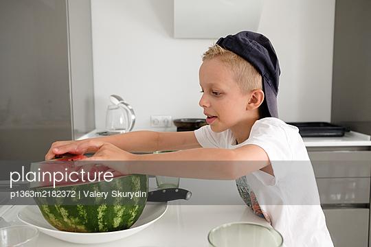 Boy eating watermelon - p1363m2182372 by Valery Skurydin