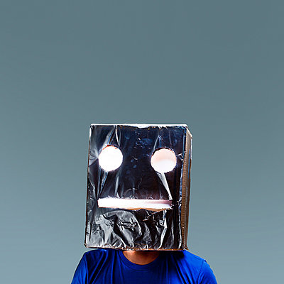 Boy with a robot mask on his head - p1165m952583 by Pierro Luca