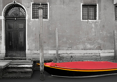 A Small Boat With A Red Cover On A Canal - p44211985f by Philippe Widling