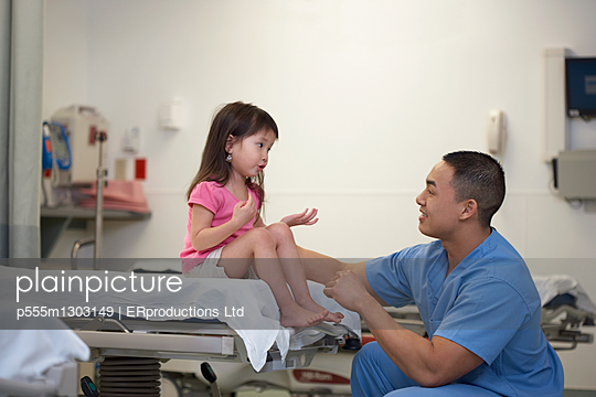 Asian male medical professional talking to patient