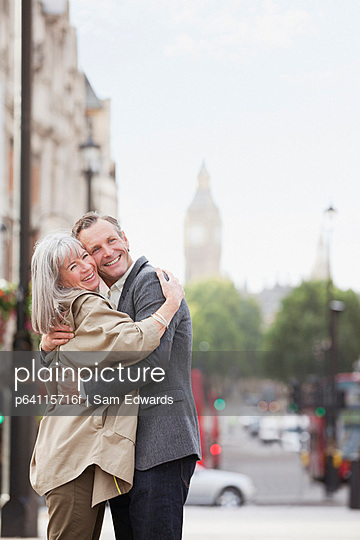 Happy couple hugging in London