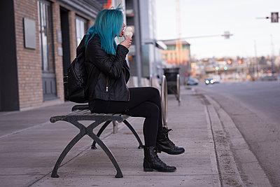Stylish woman having ice cream in city street - p1315m1566160 by Wavebreak