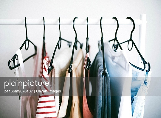 Rack filled with clothing. - p1166m2078187 by Cavan Images