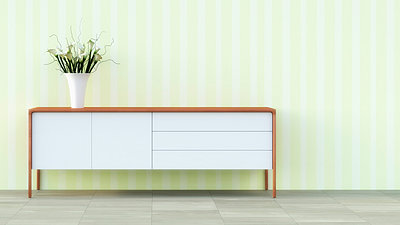 Sideboard with flower vase in front of striped wallpaper - p300m978633f by UWE