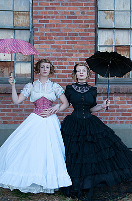Sisters in victorian attire - p920m917735 by Jude Mooney