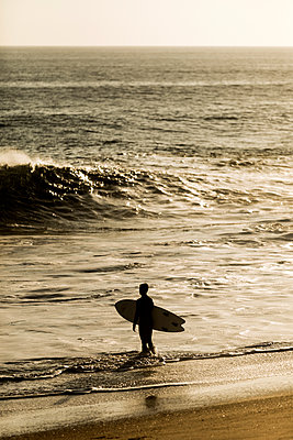 Surfer on the Beach - p1094m2057273 by Patrick Strattner