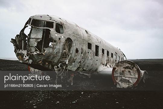 Closeup shot of Solheimasandur plane wreck DC-3 on black sand beach - p1166m2190805 by Cavan Images