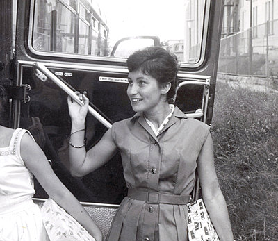 Young woman gets on a bus - p1541m2116893 by Ruth Botzenhardt