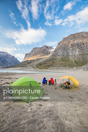 Rear view of climbers resting at basecamp after a long day of climbing - p1166m2261220 by Cavan Images