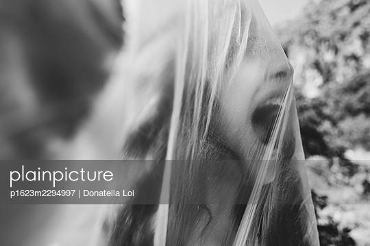 Girl under a plastic foil - p1623m2294997 by Donatella Loi