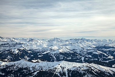 Aerial view of snowy mountains - p924m768380f by Julian Ward