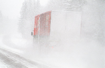Truck driving through snow storm - p1418m1571484 by Jan Håkan Dahlström