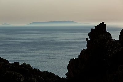 View of Asinara island in the fog - p628m1476233 by Franco Cozzo