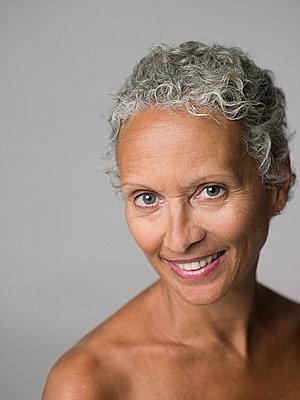 Portrait of a senior woman - p9246046f by Image Source