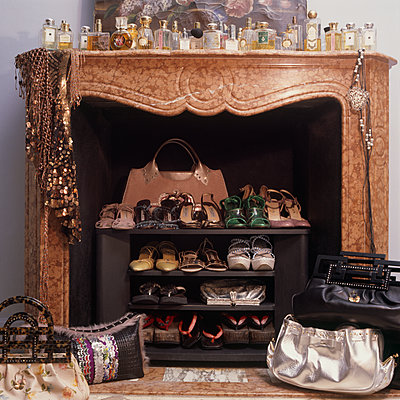 Fireplace with shoes and perfume bottles - p1311m1136878 by Stefanie Lange