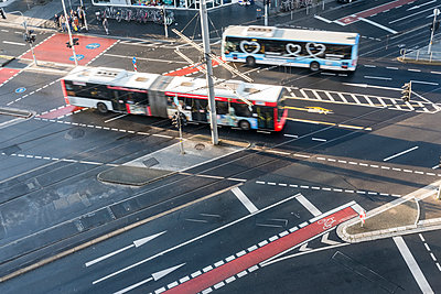 Two buses and road markings on crossroads, Bonn - p229m2196486 by Martin Langer