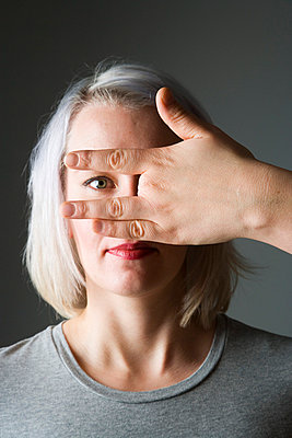 Womans hand with four fingers - p4130489 by Tuomas Marttila