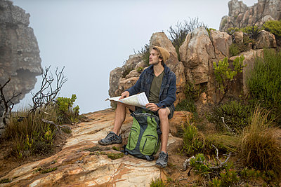 Young man on a hiking trip high in the mountains - p1355m1574137 by Tomasrodriguez