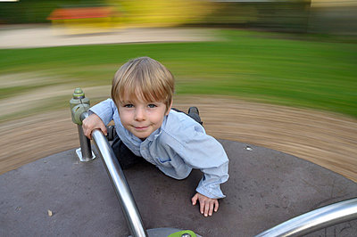 Little boy on a carousel - p3660006 by Hartmut Gerbsch
