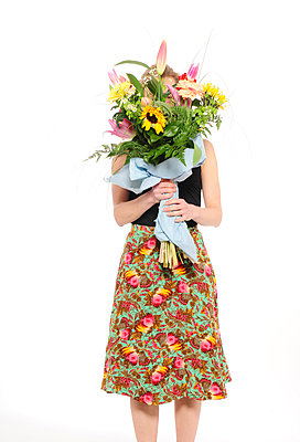 Woman holding giant bunch of flowers - p1190m2289002 by Sarah Eick