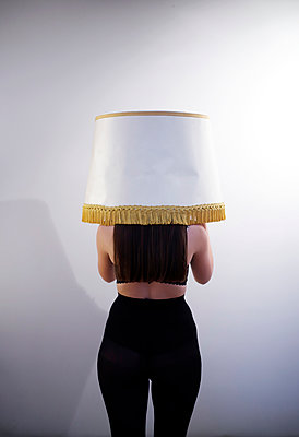 Woman and lamp shade - p1521m2128977 by Charlotte Zobel