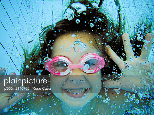 Underwater portrait of a happy girl - p300m2140763 by Xose Casal