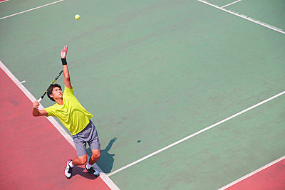 Young Japanese tennis player in action - p307m1122242f by Yusuke Nakanishi