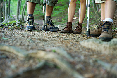 Hikers in hiking boots, low section - p623m699785f by Frederic Cirou